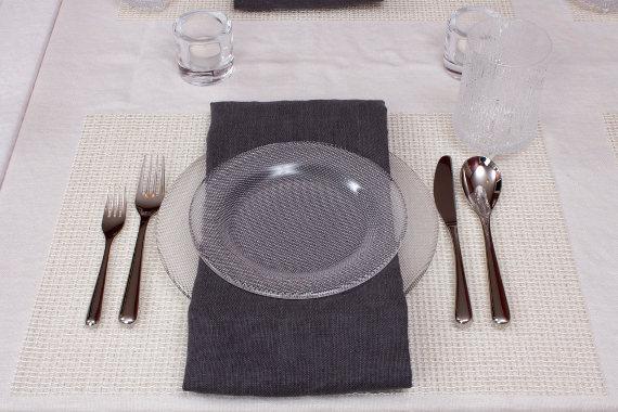 table setting with kosta boda limelight plates and iittala flatware