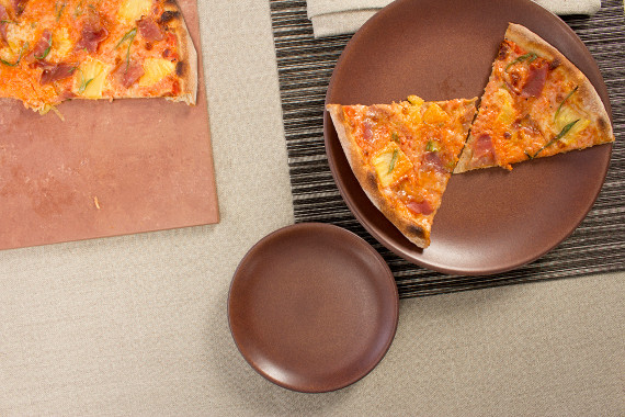 stone hearth pizza on a heath coupe dinner plate