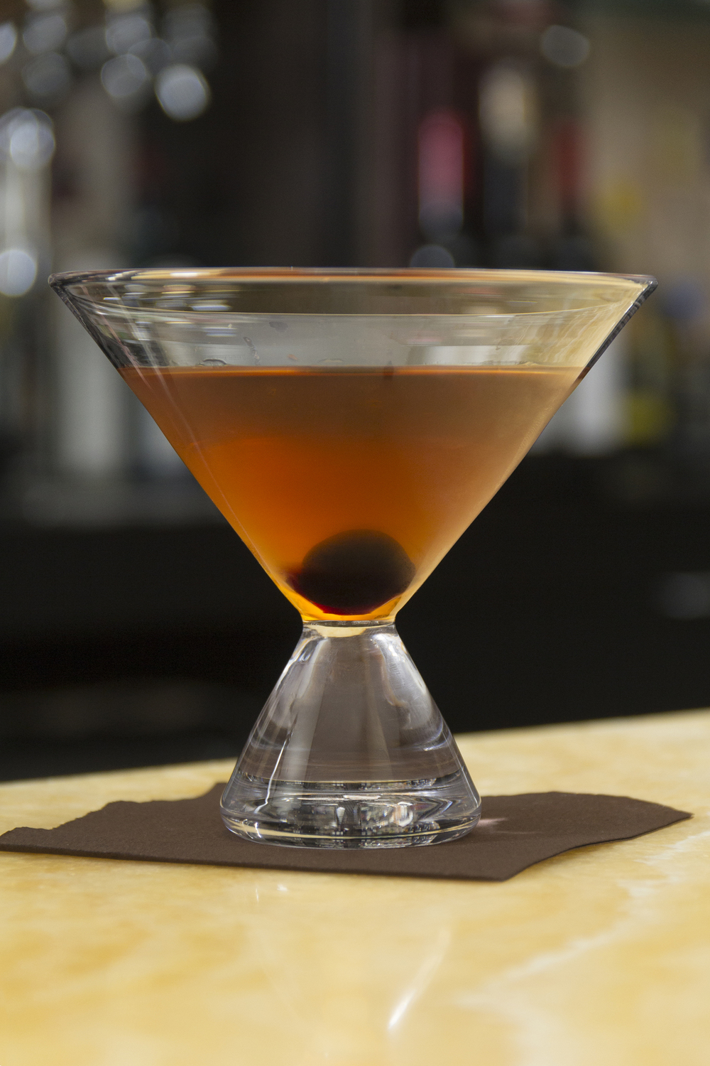 Simon Pearce Geo Stemless Martini Glass with a Classic Manhattan