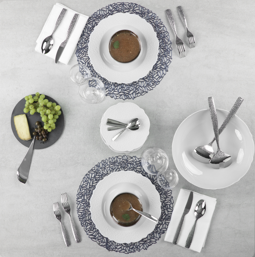 Discover the Alessi Dressed  Dinnerware,   Flatware , and  Glassware  Collections.