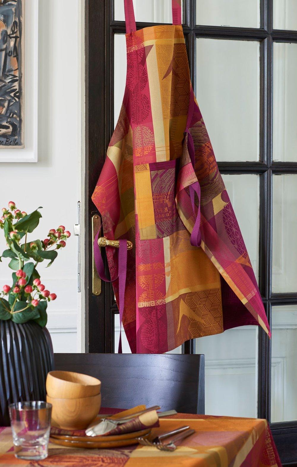 Mille Tingari Terre Rouge Apron  ,  Mille Tingari Terre Rouge Tablecloth , and  Mille Tingari Terre Rouge Napkin