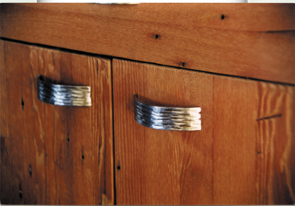 Recycled Douglas fir cabinet with hand wrought stainless steel pulls.