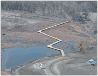 An aerial view showing the newly constructed 800-foot boardwalk across restored coastal wetland.
