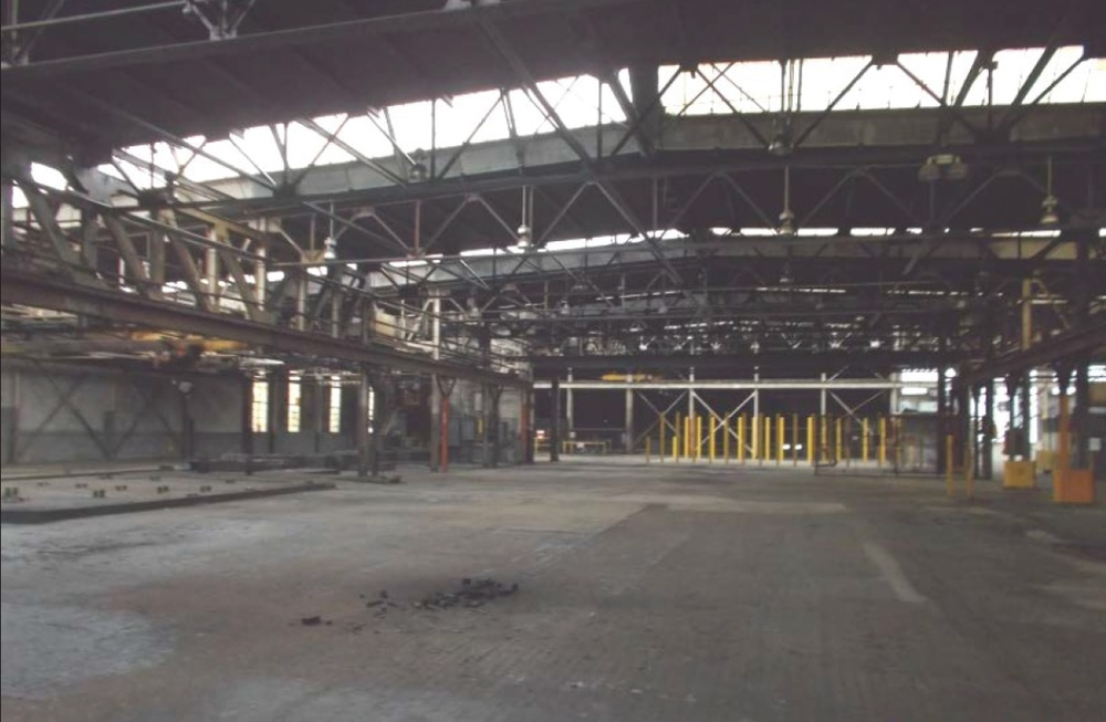 An interior view looking west at the west end of the high bay area of the south building.