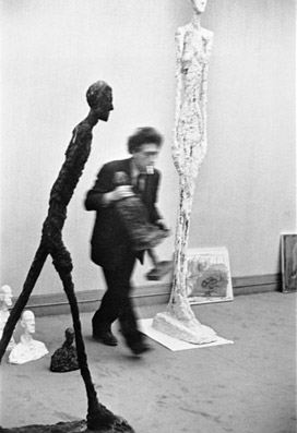 (via Wax-ing & Wayne-ing: Alberto Giacometti Introduction.) Alberto Giacometti by Henri Cartier Bresson.  Inclination forward.