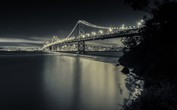 Living in San Francisco transforms me. This is the view of the bridge that I cross everyday to get to the city.    It's almost a religious procession to cross the ocean, defying the winds. The architecture is so majestic. The magic of the lights.