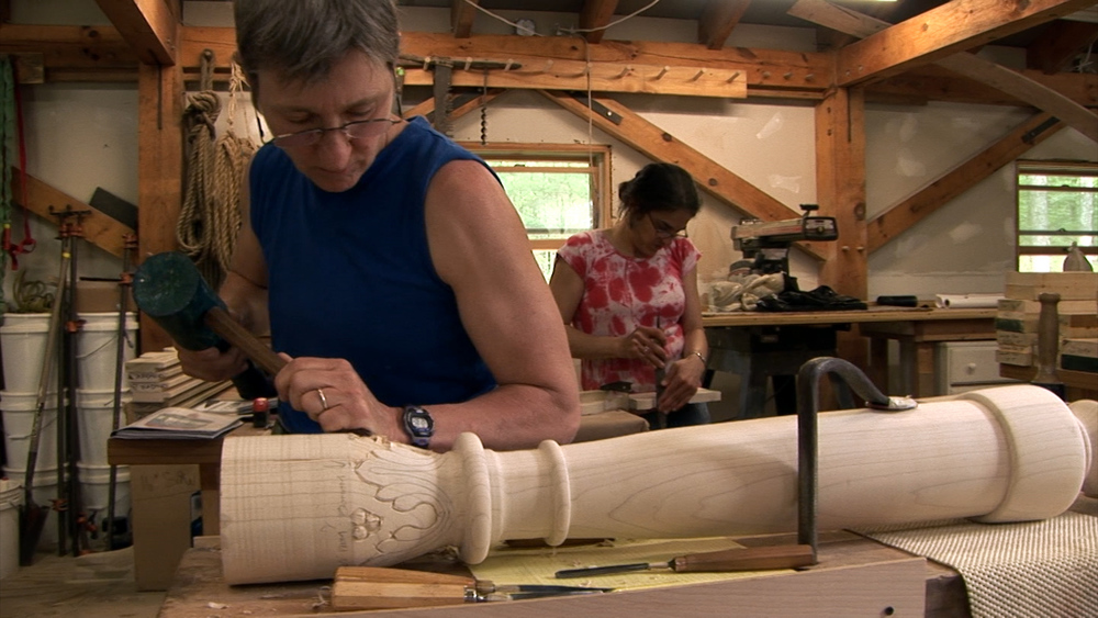 Still 3:  Judith Hanson carves a post for the Gwoździec bimah.