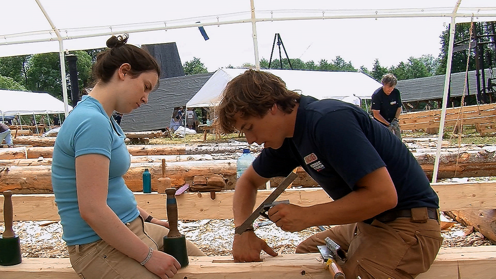 Still 18: Students carve a slot into a dimensional  timber.