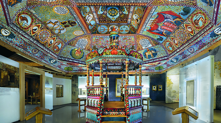 "The Gwoździec synagogue roof structure, ceiling paintings and bimah installed in the ""The Jewish Town"" gallery of the POLIN Museum of the History of Polish Jews.  Photo by Magda Starowieyska,"