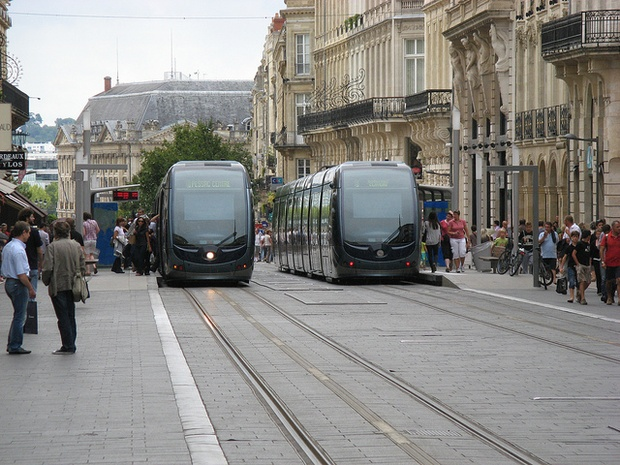 Trams arrive at stops in Bordeaux, France.  (  Andrew Batram / Flickr  )
