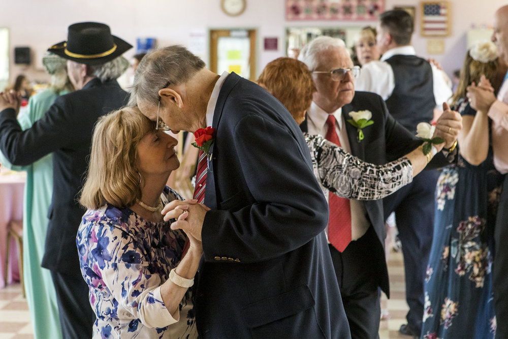 Carol Simard, left, of Chelmsford, and Tom Fall, of Chelmsford, dance together during the senior prom at Chelmsford Senior Center on April 22, 2018.