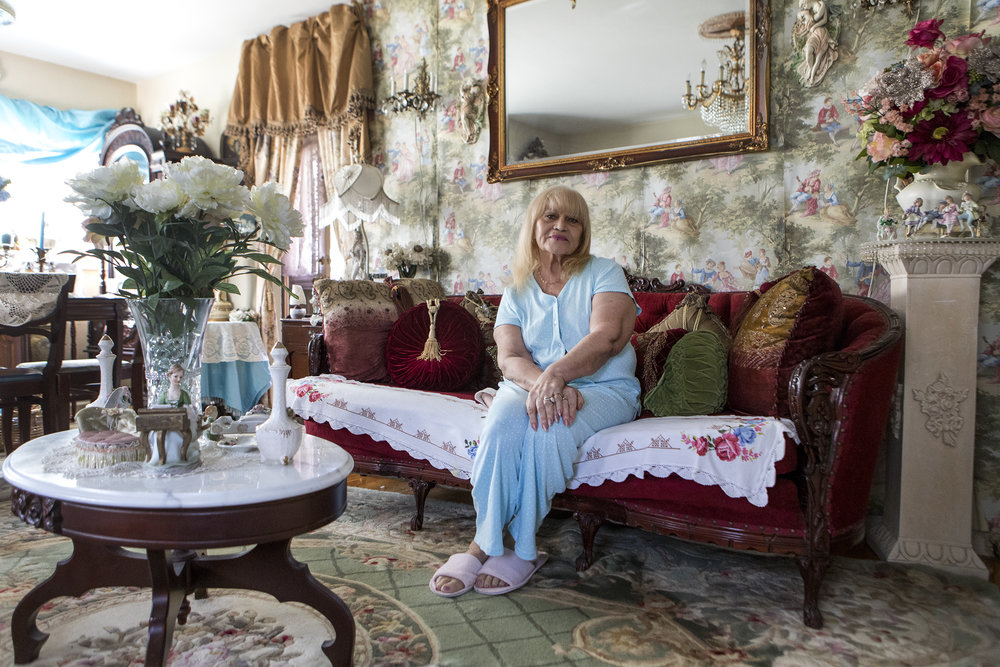 Carmen Garcia poses for a portrait at her family's home in Framingham. After moving from Puerto Rico, Garcia receives support from the Neighbor Brigade while she undergoes chemotherapy treatments.