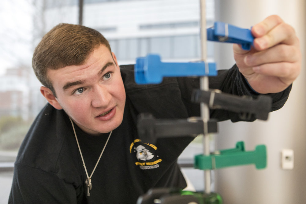 Connor Walker practices his hand coordination during an occupational therapy session at Spaulding Rehabilitation Hospital in Charlestown on Oct. 23, 2018. Initially, Walker's spinal cord injury left him paralyzed. After weeks of intensive rehabilitation, he began to regain control of his fine motor skills.