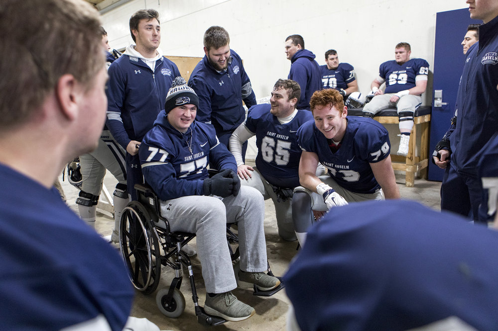Connor talks with his teammates in the locker room before their final football game of the season at Saint Anselm College in Manchester, New Hampshire, on Nov. 10, 2018.