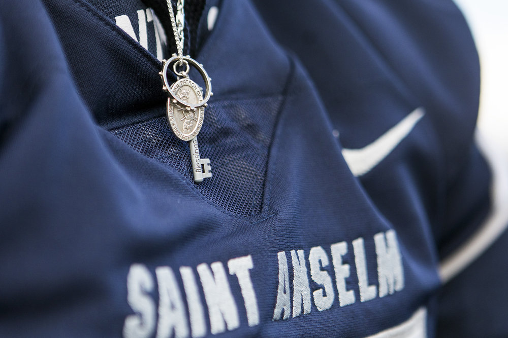 Connor Walker wears a necklace including Saint Sebastian the Patron Saint of Athletes during the final football game of the season at Saint Anselm College in Manchester, New Hampshire, on Nov. 10, 2018. Walker had accidentally forgotten to remove the necklace  during the game when he incurred his spinal cord injury.