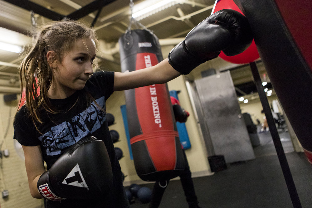 Tessa Duclos-Mazzone, 12, of Cambridge, practices boxing techniques using a punching bag during the Cambridge Police Youth Boxing Program at the Cambridge YMCA on January 24, 2019.