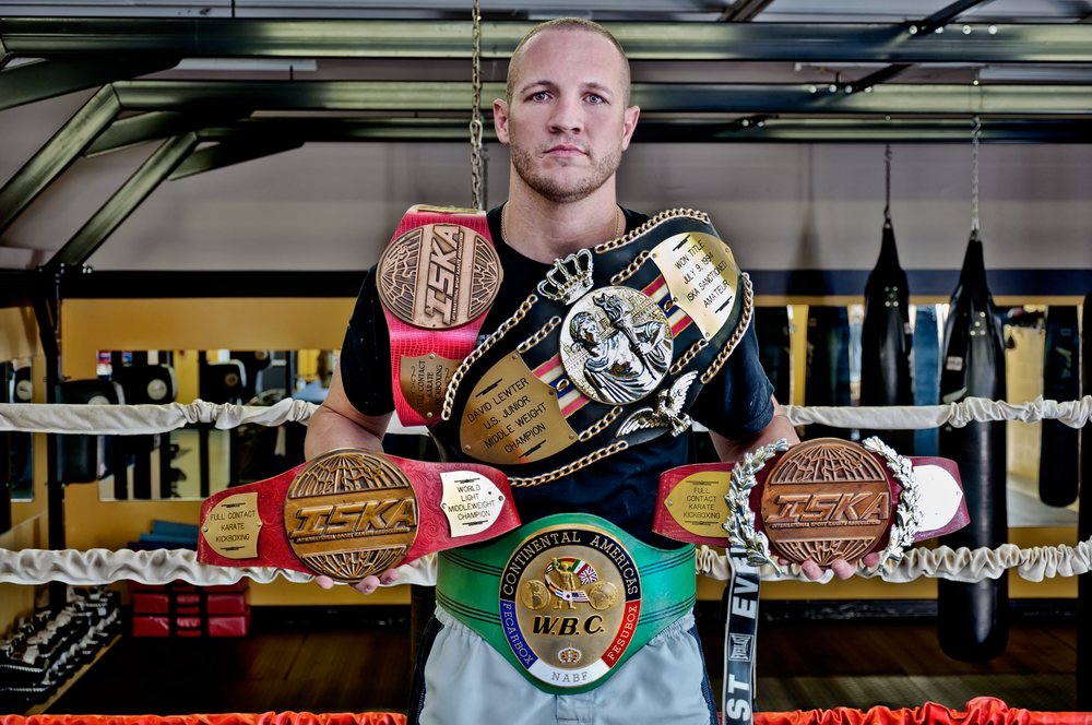 Elite Boxing West Palm Beach owner Dave Lewter with his Champion belts.