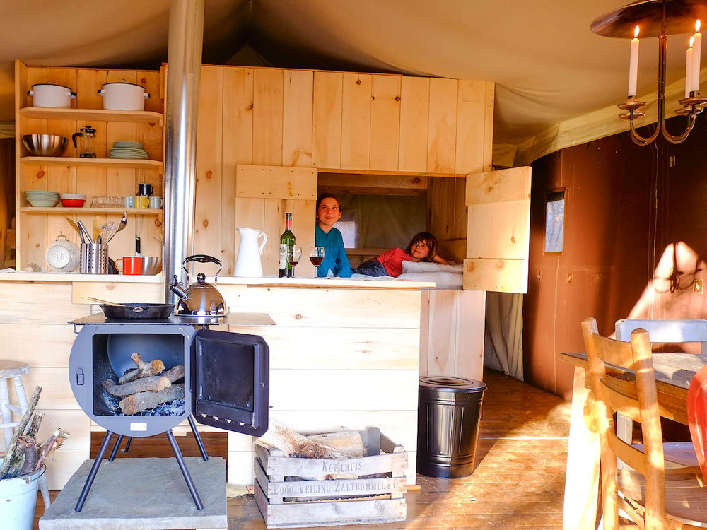 For the full experience, stay the weekend in a spacious, rustic platform tent with running water and wood stove!