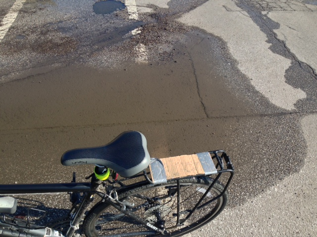 "My Bike Hack didn't work so well keeping me dry.  Time to take off the rear reflector and make room for my ""real"" fender."