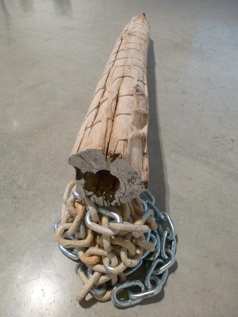 "Untitled (post), 2013, eastern white cedar, high density foam, chain, papier-mâché, L 3.5' x H 12"" x W 6"""