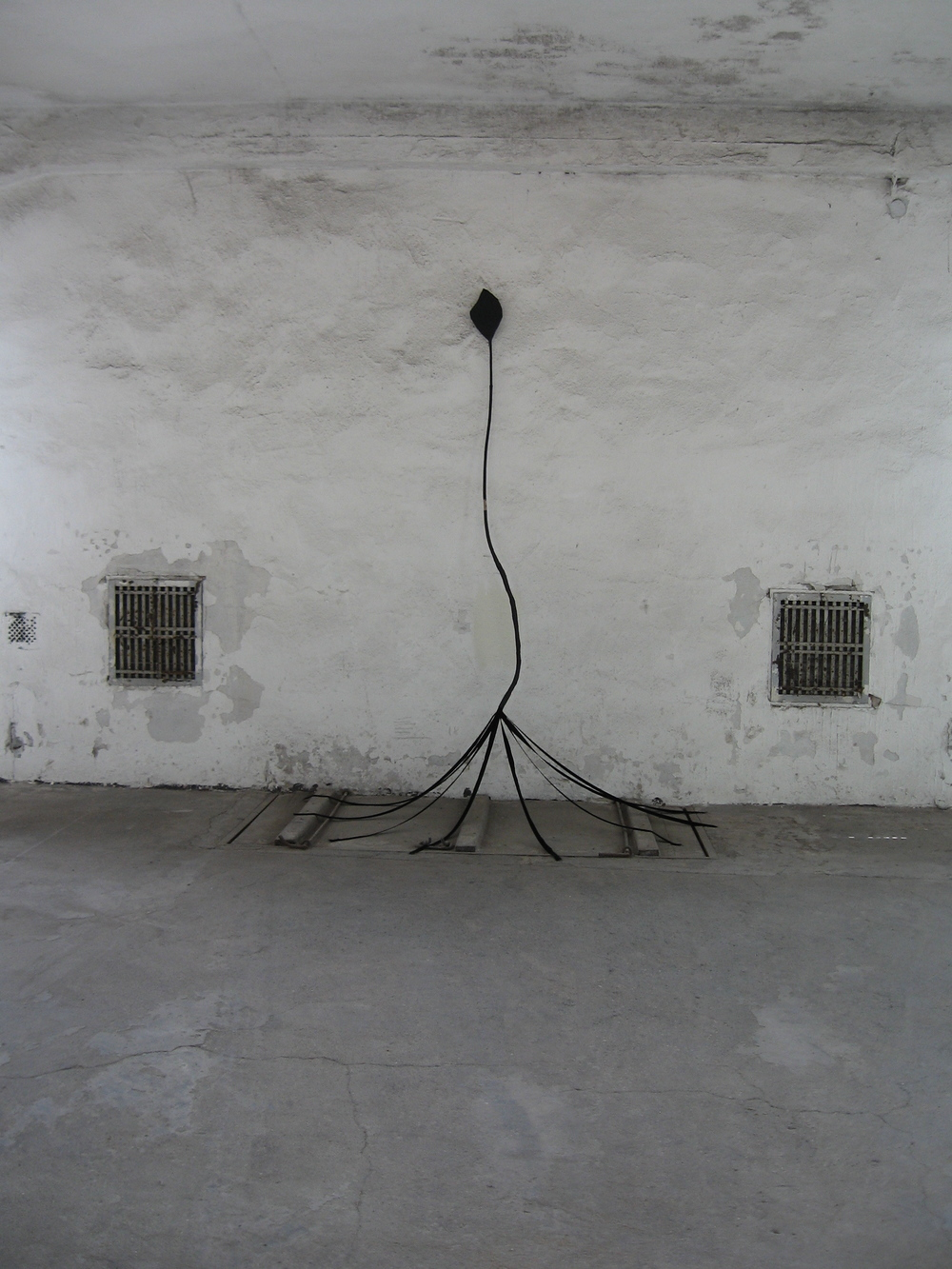 Untitled (tethered arrow), 2010, tree branch, papier-mâché, velvet ribbons, charcoal, H 7' x W 4.5' x D 3'