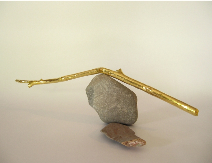 "Sticks and Stones,  2011, stones, mobile twig, gold leaf, H 5"" x W 7"" x D 5"""
