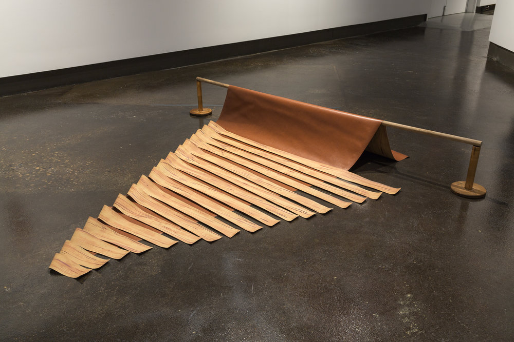 "Rip-Cut , 2015, acrylic on sliced faux leather vinyl, twine spools, found wooden dowel,105"" x 102"" x 13.5"". Photo: ©Scott Lee.       Normal.dotm   0   0   1   13   76   Barb   1   1   93   12.0                   0   false       18 pt   18 pt   0   0     false   false   false                                /* Style Definitions */ table.MsoNormalTable {mso-style-name:""Table Normal""; mso-tstyle-rowband-size:0; mso-tstyle-colband-size:0; mso-style-noshow:yes; mso-style-parent:""""; mso-padding-alt:0cm 5.4pt 0cm 5.4pt; mso-para-margin:0cm; mso-para-margin-bottom:.0001pt; mso-pagination:widow-orphan; font-size:12.0pt; font-family:""Times New Roman""; mso-ascii-font-family:Cambria; mso-ascii-theme-font:minor-latin; mso-fareast-font-family:""Times New Roman""; mso-fareast-theme-font:minor-fareast; mso-hansi-font-family:Cambria; mso-hansi-theme-font:minor-latin;}"