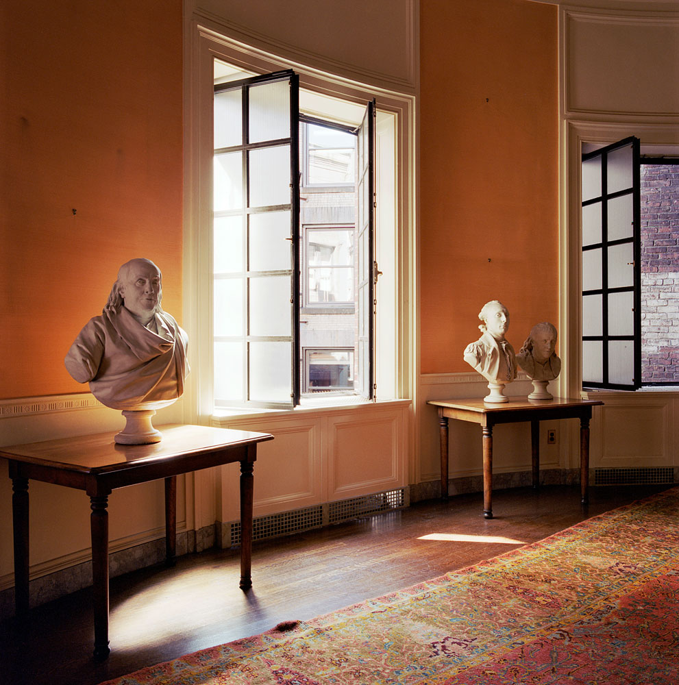 Before renovation: Trustees' room with three busts