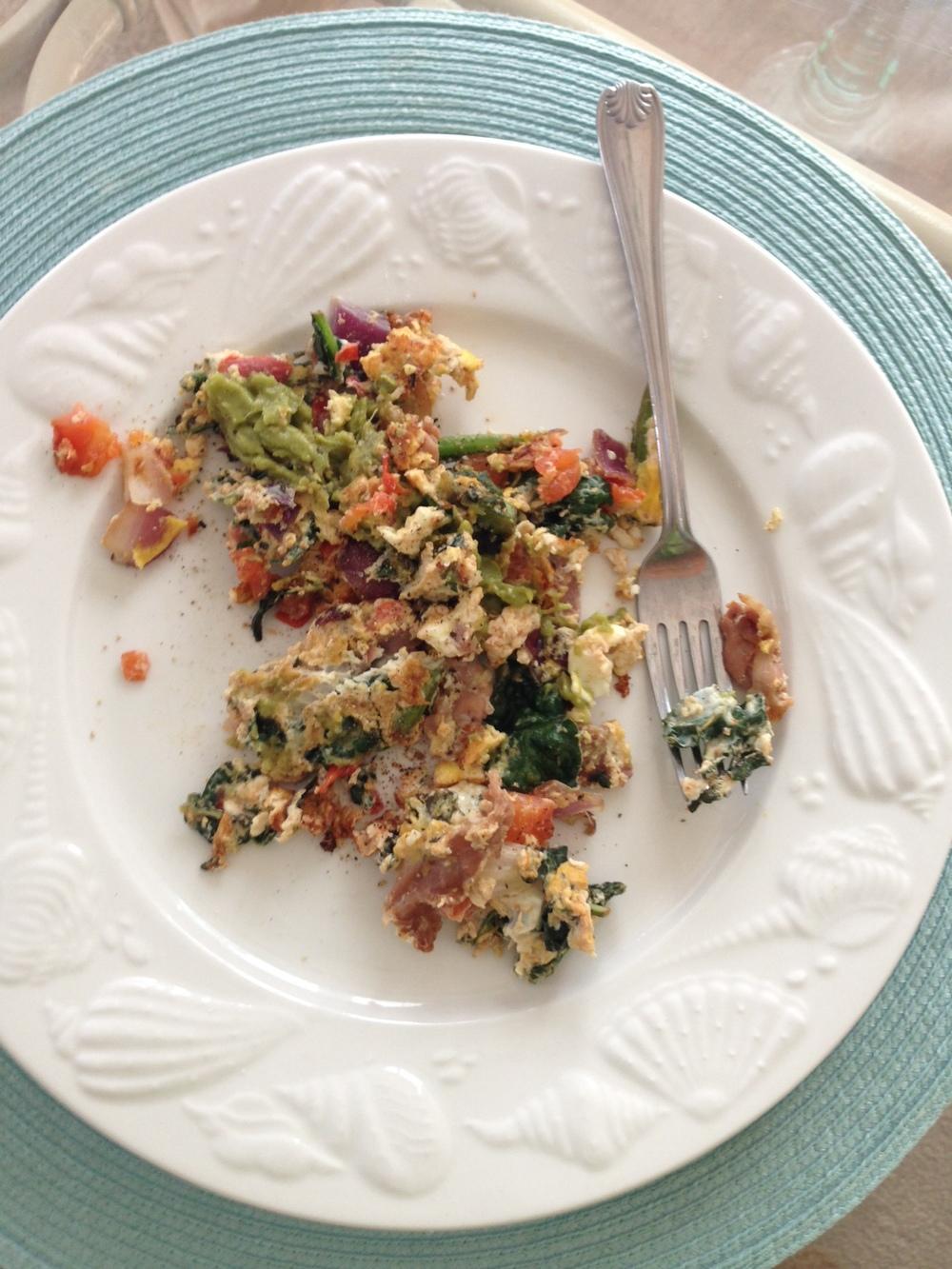 Breakfast Scramble: eggs, kale, tomatoes, red onion, GUAC and prosciutto! Delish.