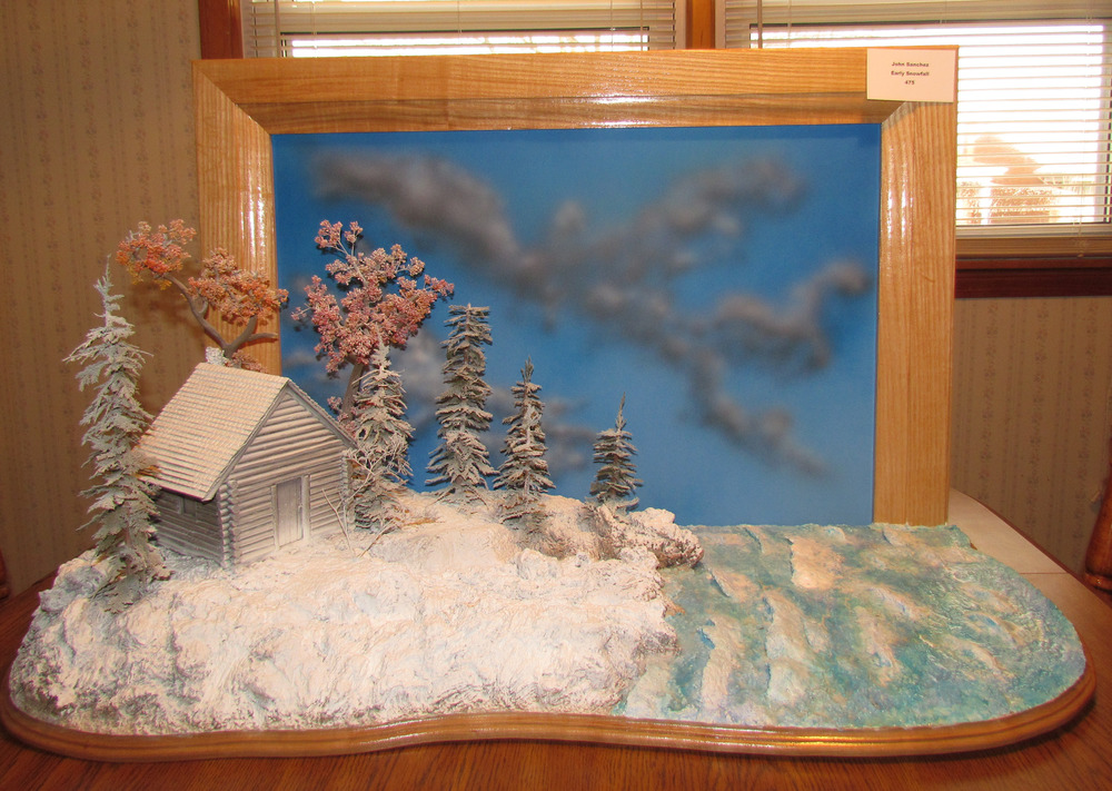 The log cabin was built from scratch.The water was made from Future Floor Polish.