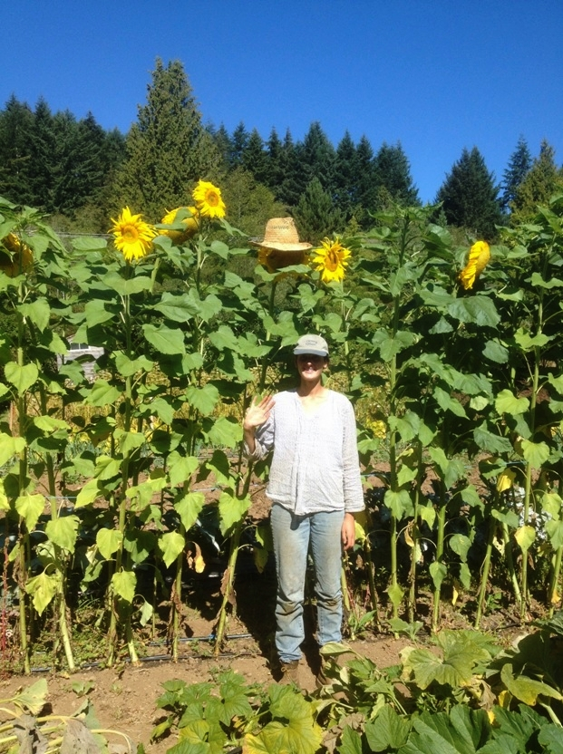 Sharing hats with sunflowers.