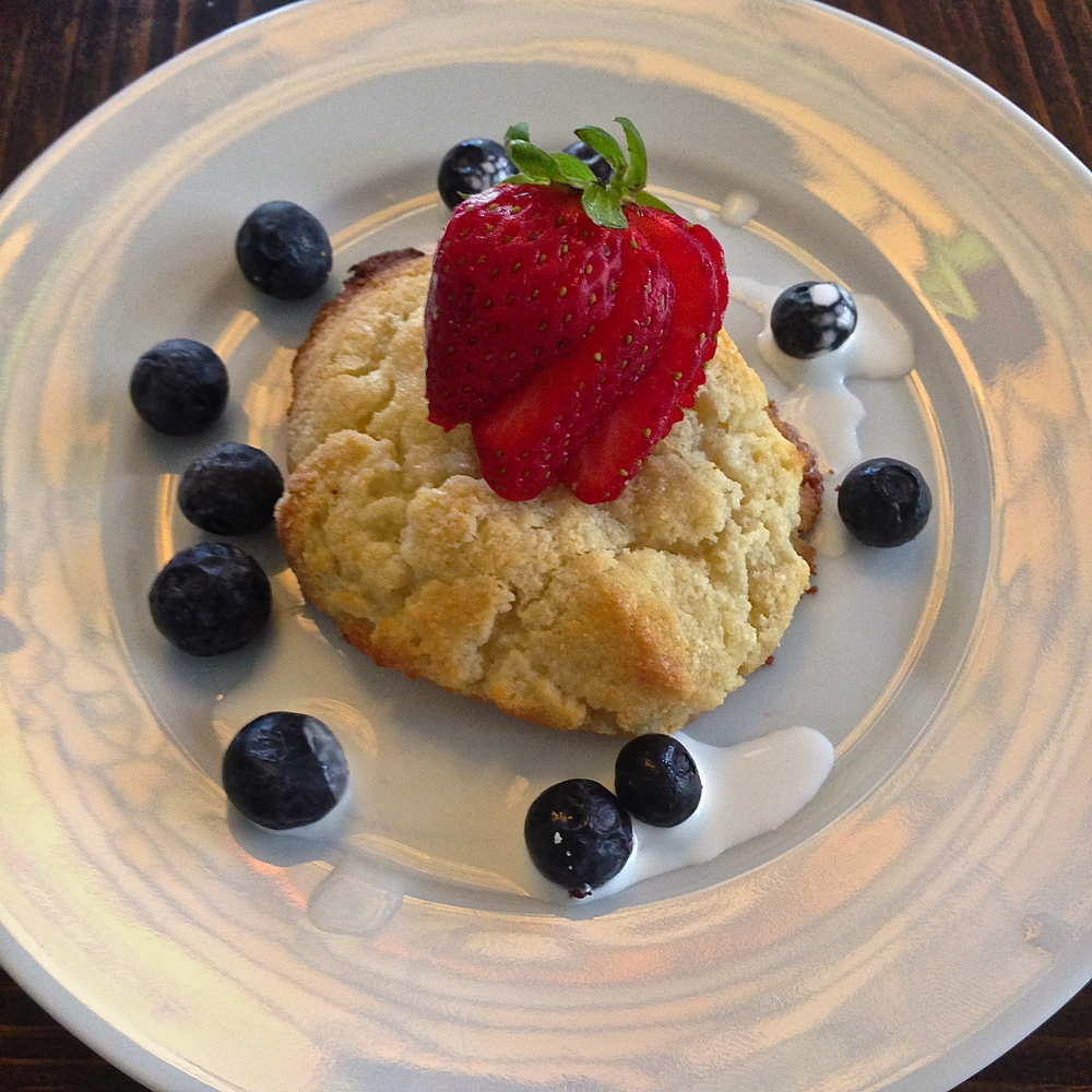 Orange Scones with fresh berries and whipped coconut cream
