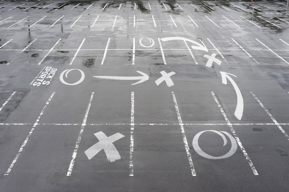 Parking lots outside Dick's Sports stores would be given playbook style illustrations