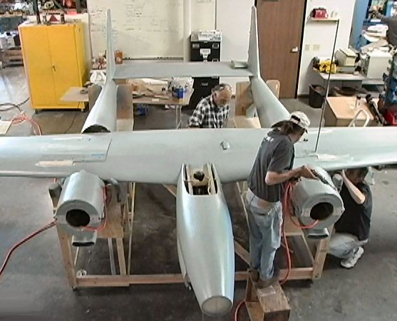 Mounting the re-manufactured wing to the fuselage section.