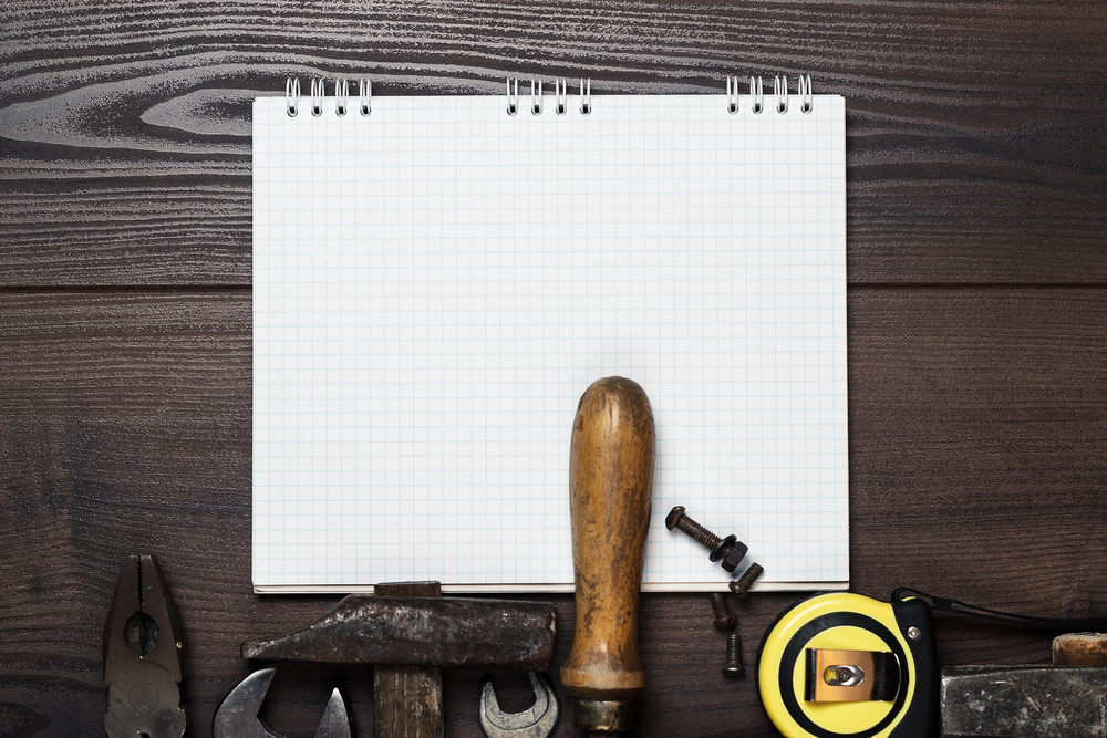 bigstock-construction-tools-and-notepad-42222070.jpg