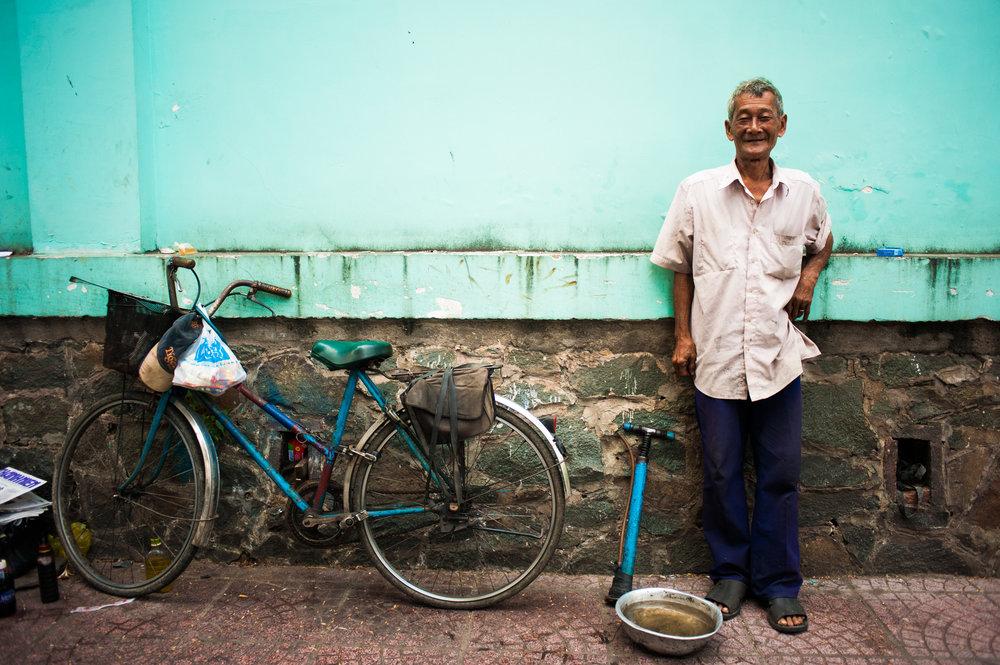 Bicycle Repairman - Saigon, Vietnam