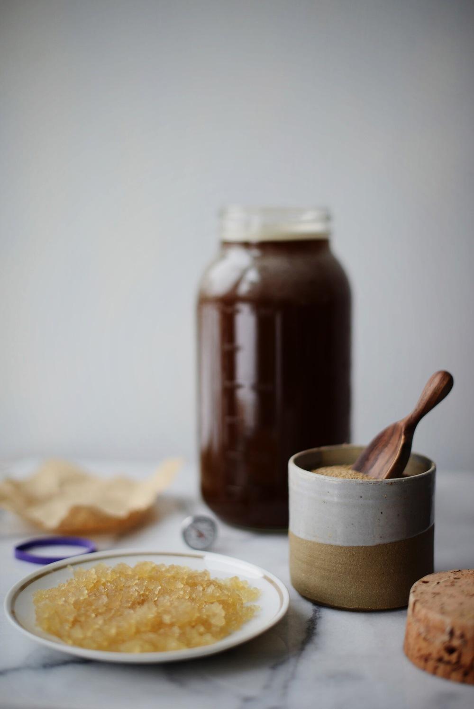 water kefir grains on plate, rapadura sugar water in mason jar
