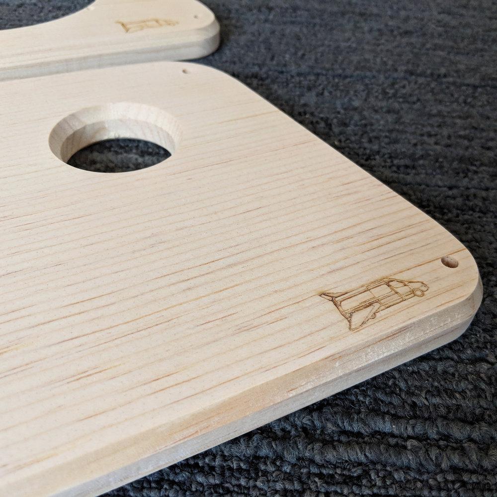 NCV3 Speaker Panel Pine Logo Detail.jpg