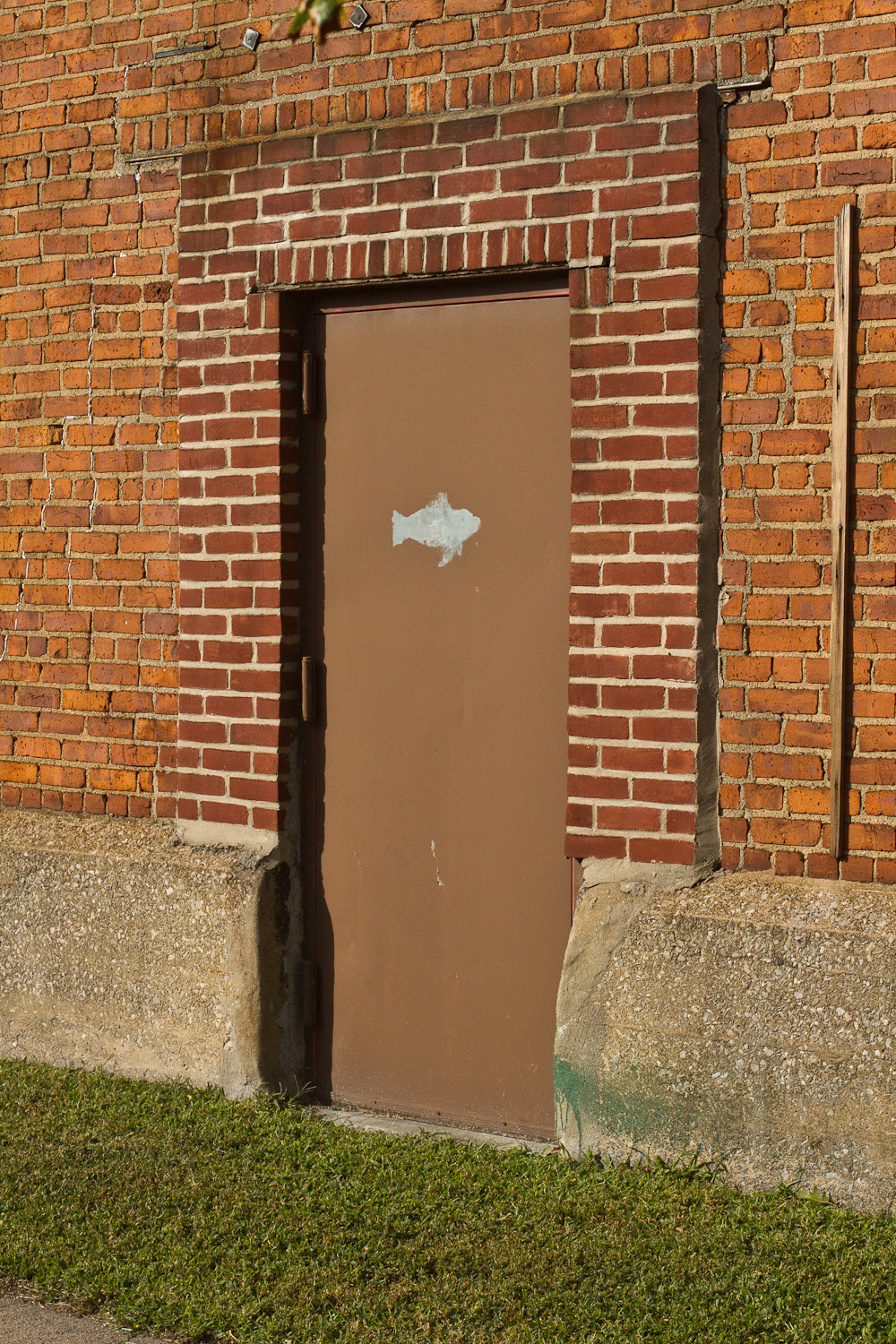 Mysterious door outside a petroleum processing facility on Newtown Creek.