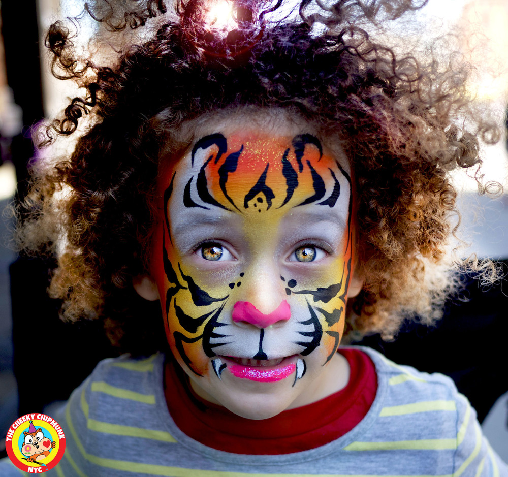 "Tiger face painting by Lenore Koppelman aka ""The Cheeky Chipmunk"" in NYC"