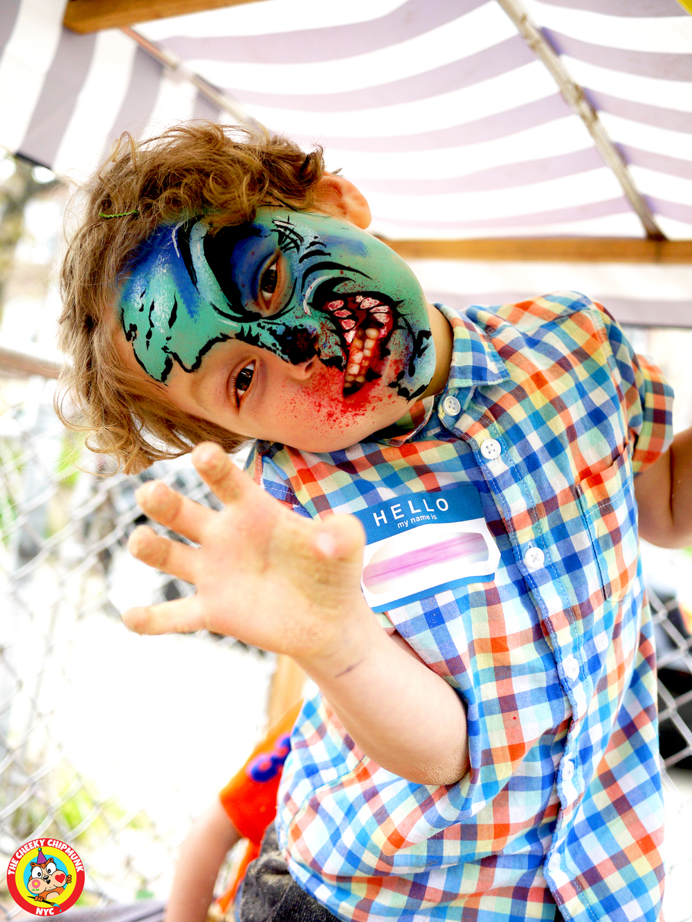 "Zombie kid face painting by Lenore Koppelman aka ""The Cheeky Chipmunk"" in NYC"