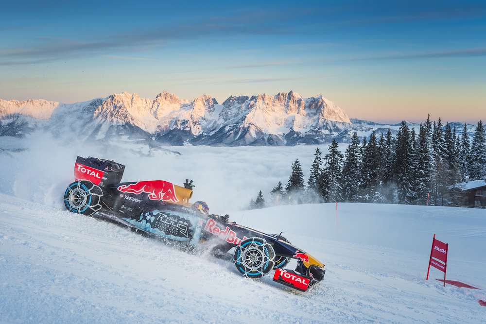Max Verstappen driving a Red Bull RB7 in the snow slopes of Austria