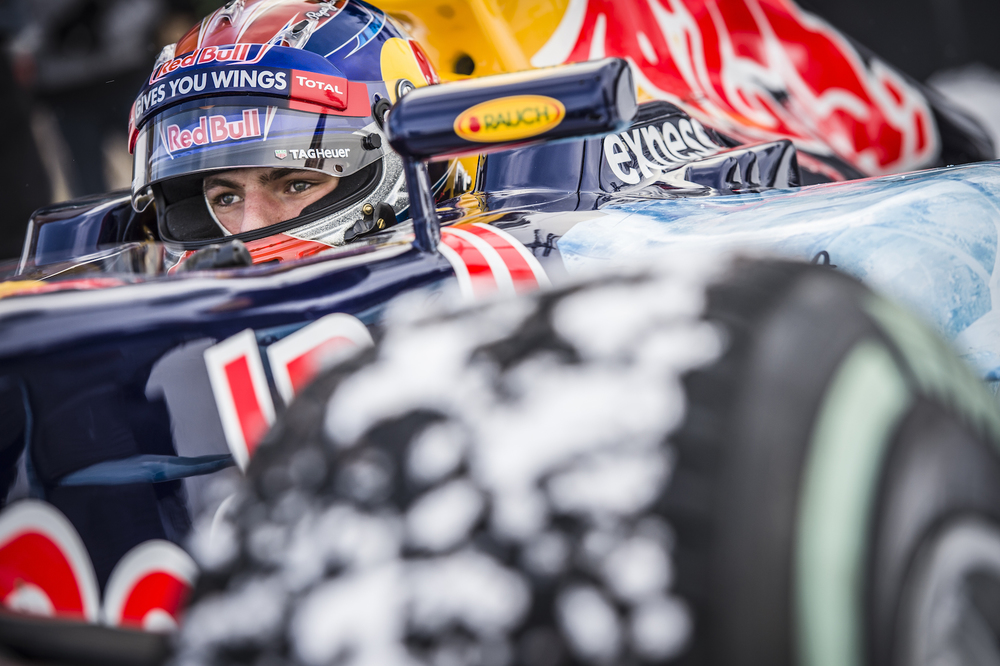 Max Verstappen and the Red Bull RB7 in the snow