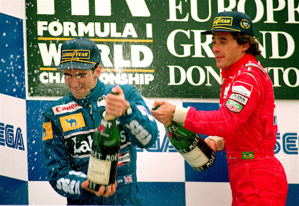 Senna celebrating his victory at Donington Park in 1993