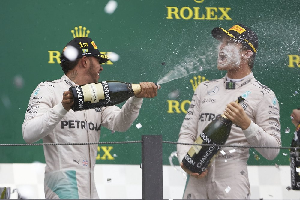 Salracing - Lewis spraying some champagne on Nico