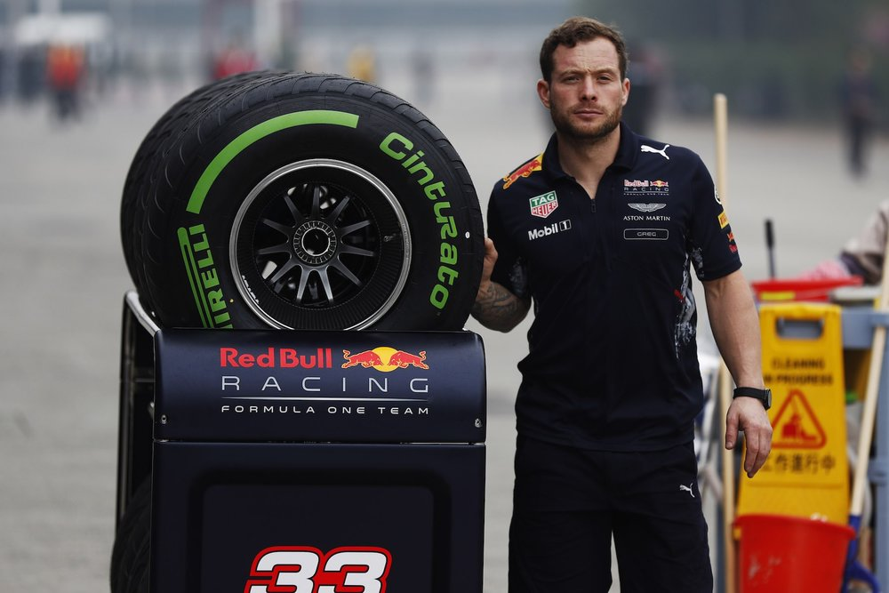 2017 Pirelli Intermediate tire being pulled by RBR mechanic | 2017 Chinese GP copy.jpg