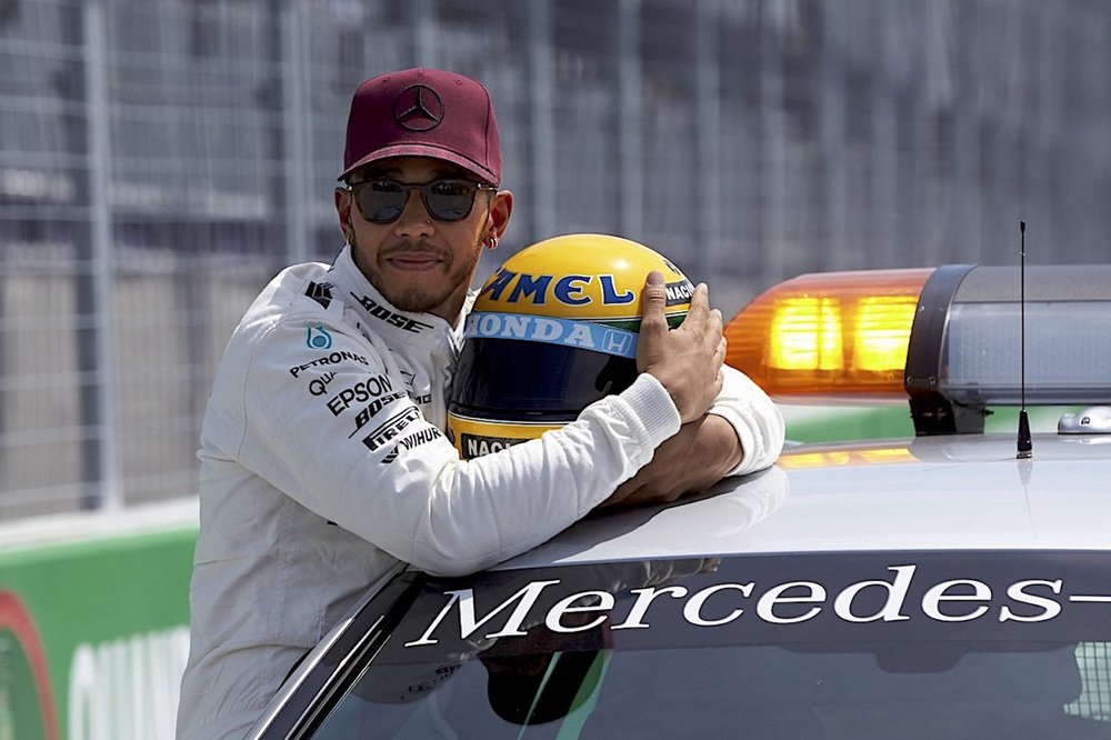 2017 Lewis Hamilton with Ayrton Senna helmet from 1987 gifted by Senna family for equalling 65th poles in F1 copy.jpg