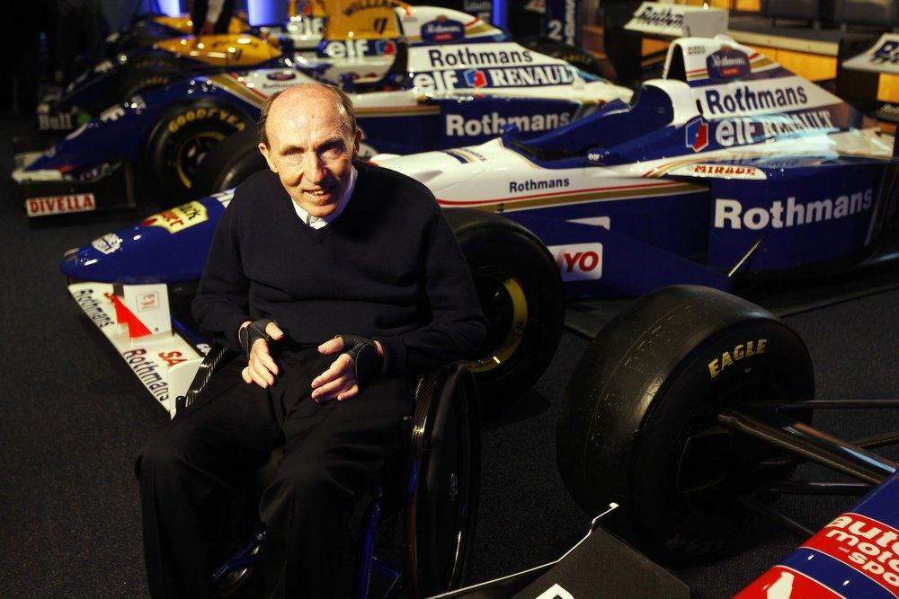 Sir Frank Williams and his cars.jpg