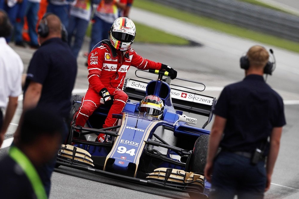 U 2017 Pascal Wehrlein giving Vettel a lift | 2017 Malaysia GP copy.jpg