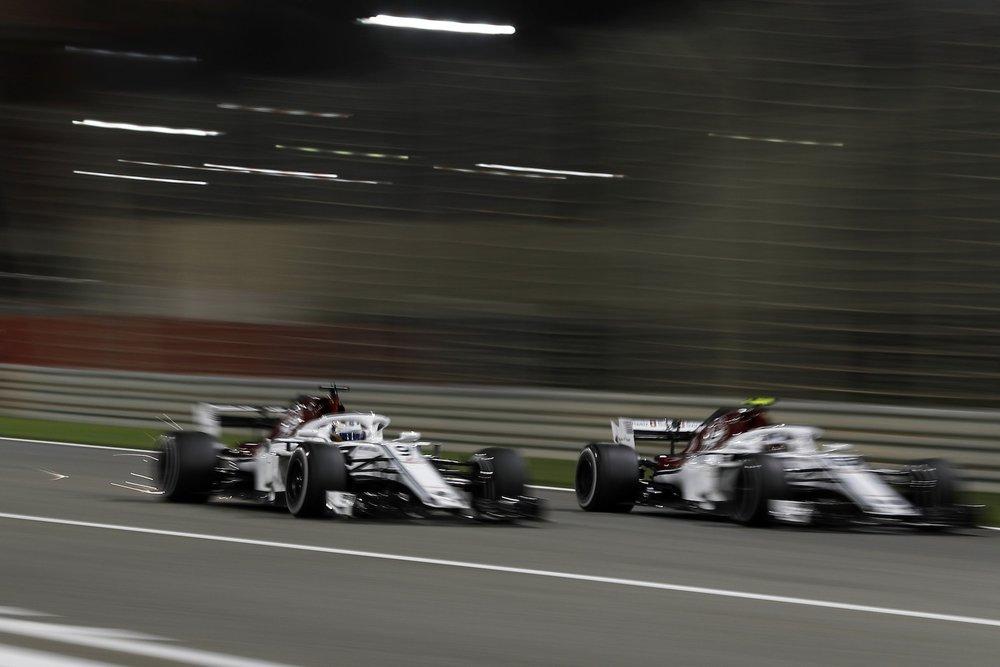 L 2018 Alfa Romeo Sauber teanmates | 2018 Bahrain GP 1 copy.jpg